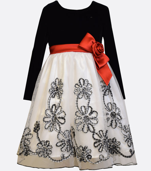 Bonnie Jean black stretch velvet and white embroidered bonaz dress with long sleeves and a red satin waist bow.