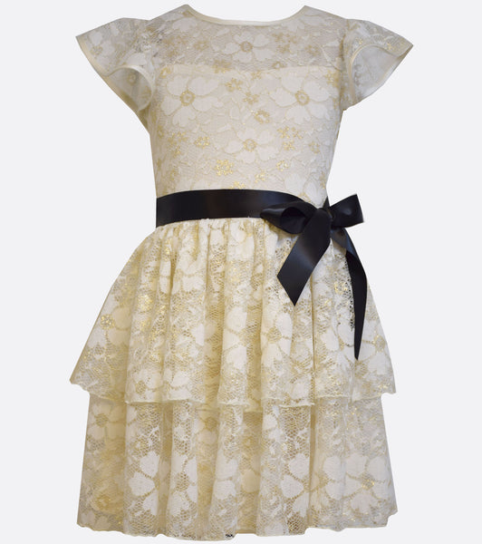 Bonnie Jean ivory stretch lace dress with multi-tiered skirt and black waist bow.