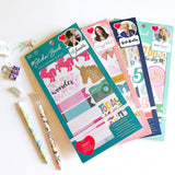 Includes a mix of clear, cardstock and foiled accent stickers. Designs feature phrases, letters and accents that coordinate with the designers' style.