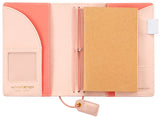 There's no better place to keep your memories than the Color Crush Pocket Traveler's Journal. This high-quality notebook features a standard, blank notebook with creamy paper and a beautiful faux leather cover. You can personalize and build your own custom notebook that fits your lifestyle.