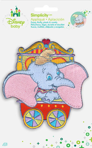 Disney Baby appliques. Dumbo iron on applique features embroidered Dumbo In Red Circus Car. Fuzzy, fluffy, plush & comfy. Iron on baby apparel, crafts, nursery decor and more! Embroidered patches can be ironed on or sewn. Perfect for Clothes & Backpack