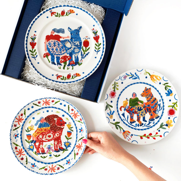 Plate collection with animals and flowers by mixed media artist Auracherrybag