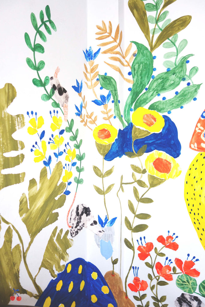 Section of an illustrated mural that shows different flowers by mixed media artist Auracherrybag