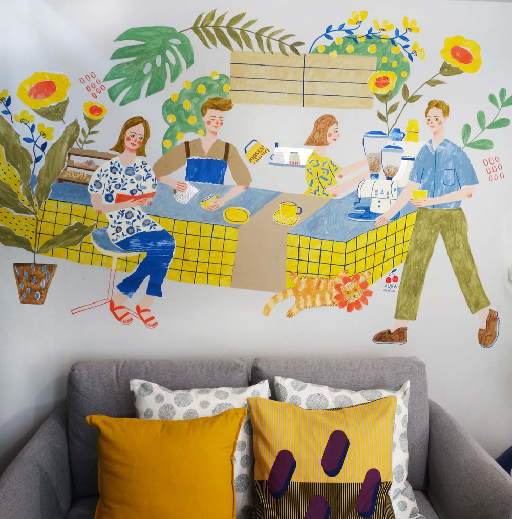 Mixed media mural by Auracherrybag that shows people drinking coffee and reading a book at a cafe surrounded by flowers