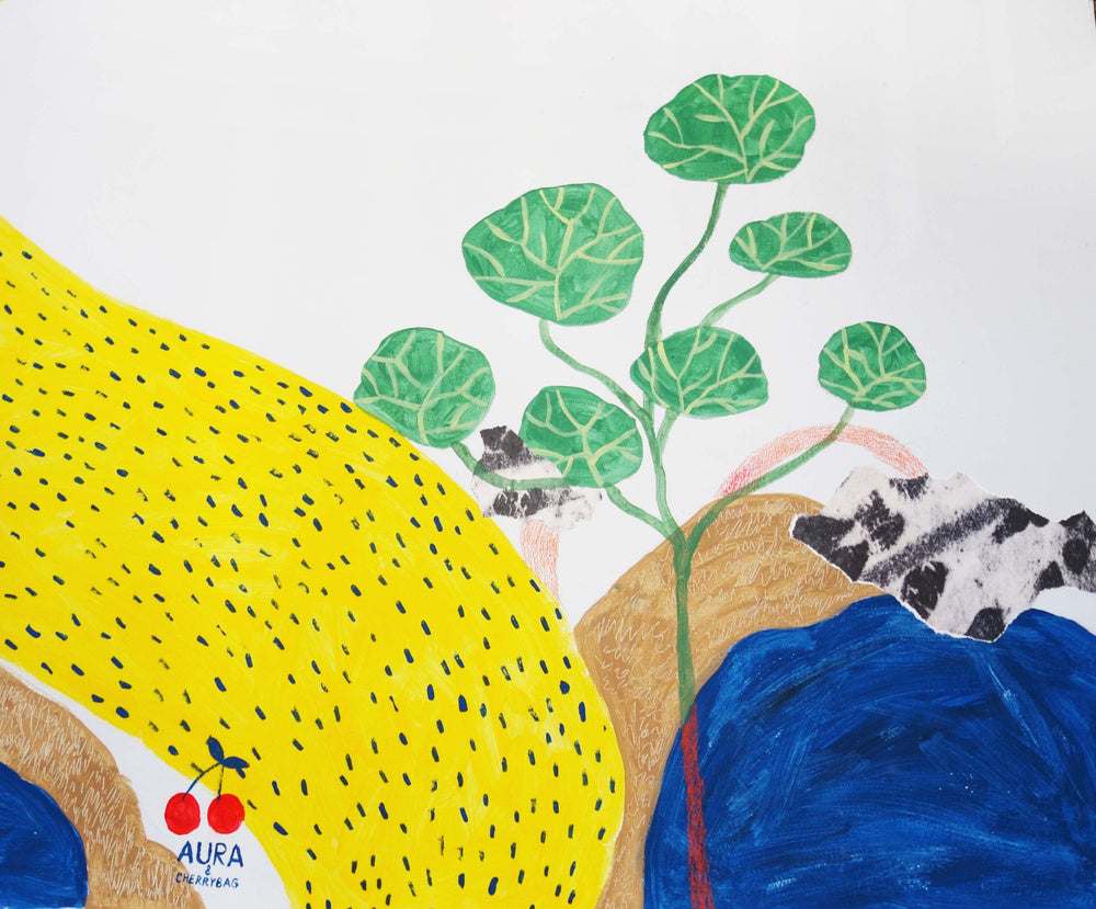 A close up of a mural by mixed media artist Auracherrybag that shows a yellow dotted road and some greenary