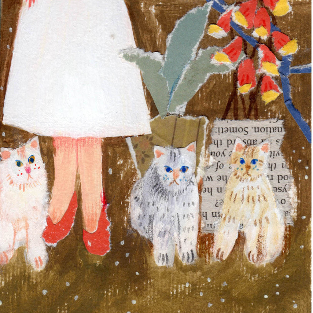 Close up of a wedding card designed by mixed media artist Auracherrybag that shows three cats and flowers near the brides feet