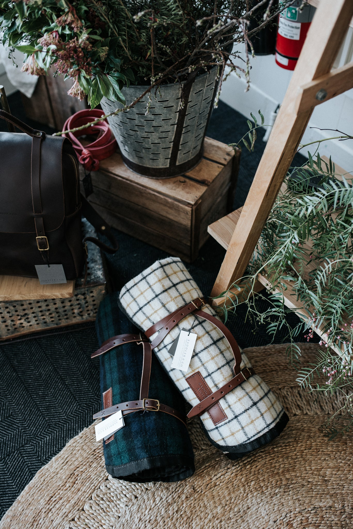Wool and leather Picnic blankets in Wellington Popup shop, featuring Armadillo & Co rug