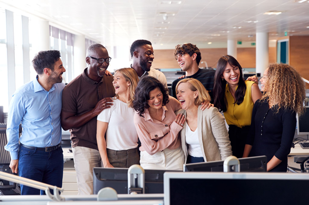 happy employee business team working in modern office laugh
