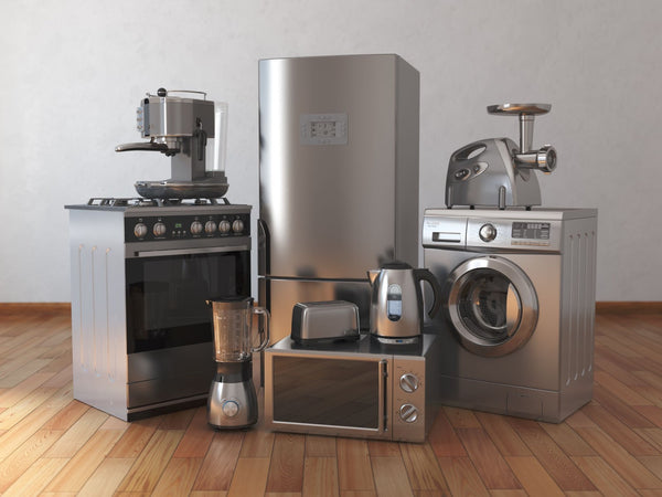 New home kitchen appliances that are all made out of stainless steel.