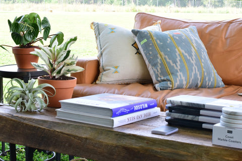 table with coffee table books on it and plants