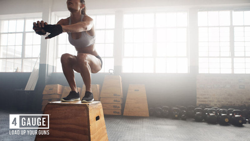 WOman doing interval training box jumps