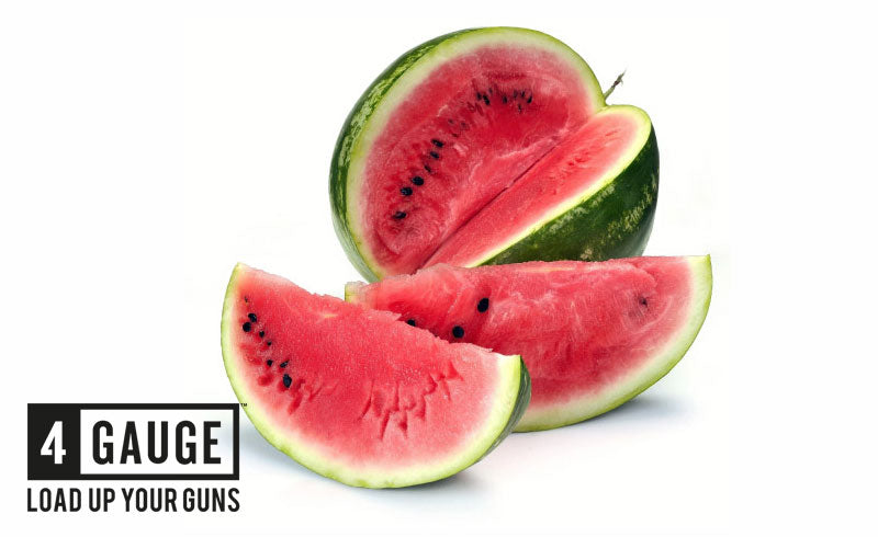 A picture of a watermelon sliced and presented in front of a white background.