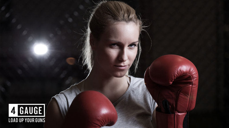 Fit woman boxing to keep fit taking a pre workout