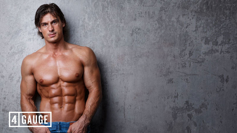 Handsome male athlete showing off ab s and muscles