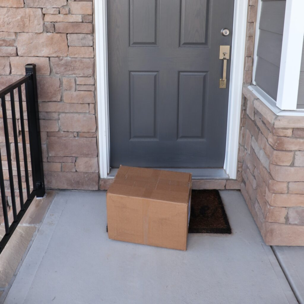 Our first box of books sitting at the doorstep