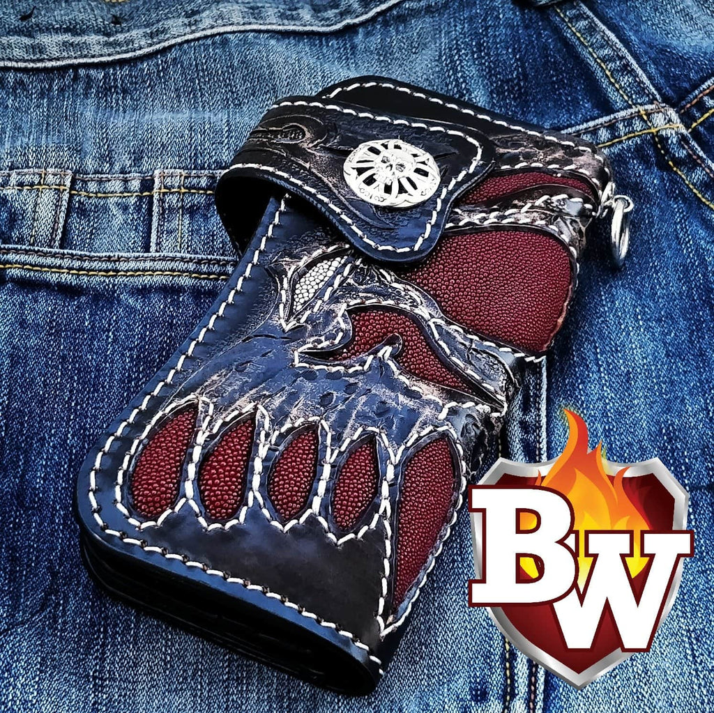 "This is an image of the 8"" biker wallet called Redbeard's Skull.  This is an extremely well handmade biker wallet.  It uses red stingray skin and hand tooled leather to achieve this very cool overall look.  The concho and chain secure are .925 silver."