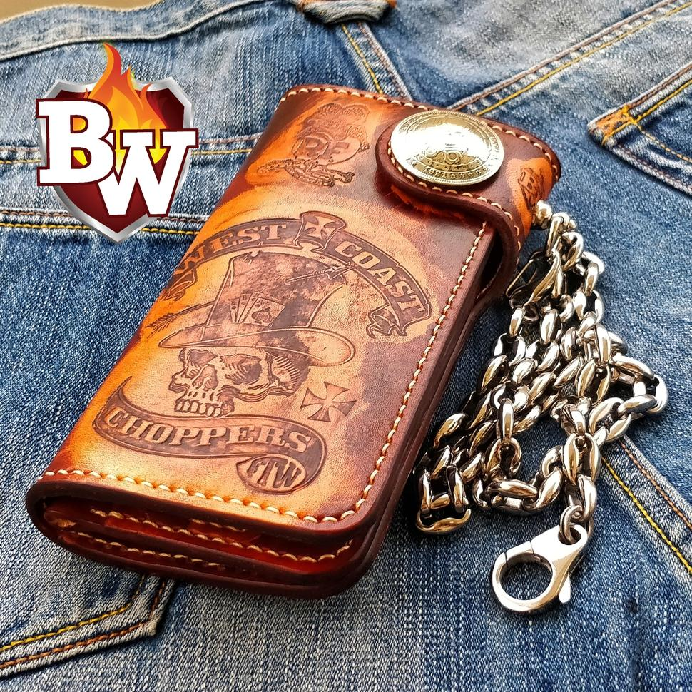 Pictured here is the Kingpin Biker Wallet.  Black stingray and accented hand tooled leather.  The color scheme is black, and a yellowish gold accent.  Cool as hell.