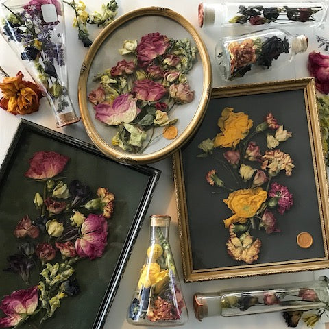 Flask and Frames of Hope with funeral flowers
