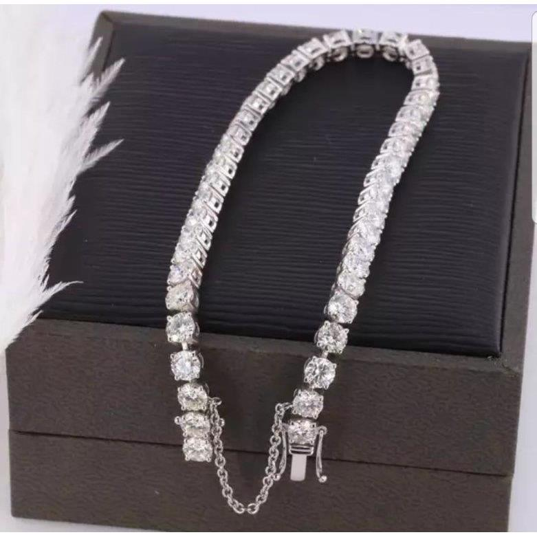 Exceptionally brilliant Round Zirconite Cubic Zirconia CZ  w/Safety Chain Tennis Bracelet. 698Bcast,