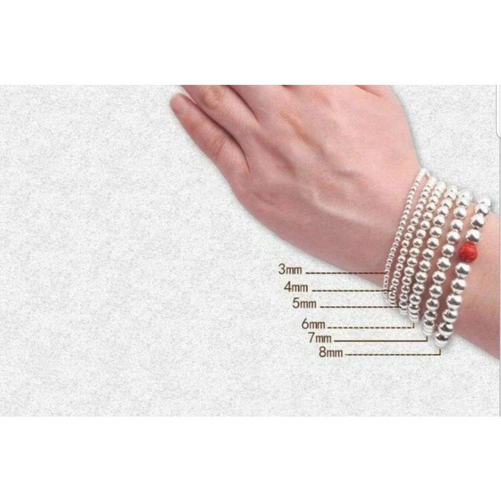 Stainless Steel Gold Bead stretch Bracelet by Zirconite