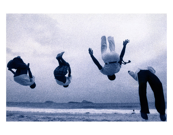 kids doing backflips on beach