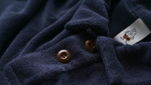 Birdwell's infamous Terry Polo Shirt in navy with brown, wooden buttons.