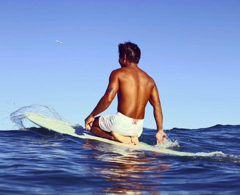 Arthur Toots Anchinges on surfboard