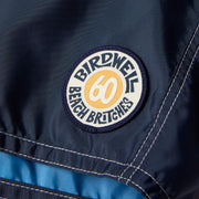 311LeroyBoardShort60thAnniversary_Mens_Boardshorts_NvyYlwSky_up_close_patch