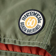 311LeroyBoardShort60thAnniversary_Mens_Boardshorts_OlvPapYlw_up_close_patch