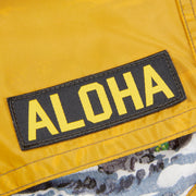 311Limited-EditionAlohaBoardShorts_MENS_BOARDSHORTS_Gold_MA3311 Close Up Patch View