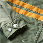 CompetitionJacketNewFit_Mens_Outerwear_OliveGold_up_close_sleeve