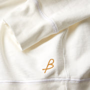 QuarterZipLS_Mens_Tops_White_up_close_logo