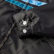 QuiltedCompetitionJacket_Mens_Outerwear_BlackSkyBlueTurquoise_up_close_sleeve