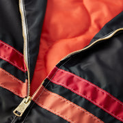 QuiltedCompetitionJacket_Mens_Outerwear_BlackRedPaprika_up_close_zipper