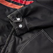 QuiltedCompetitionJacket_Mens_Outerwear_BlackRedPaprika_up_close_sleeve