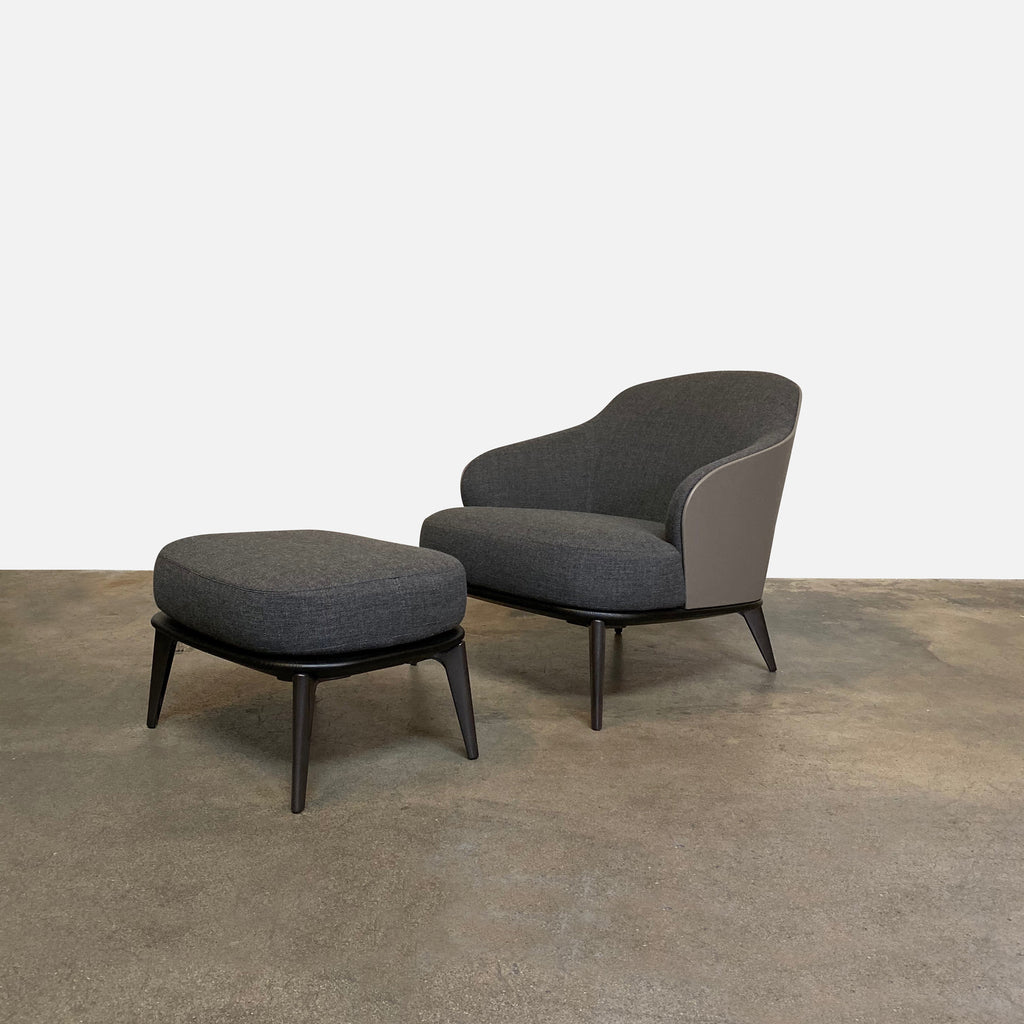 Minotti 'Leslie' Armchair & Ottoman  The Minotti 'Leslie' chair and ottoman is sensuous with soft contours and rich materials. Textured gray fabric is backed by smooth, hard taupe colored leather. An ebony stained wood base defines and compliments.  Los Angeles
