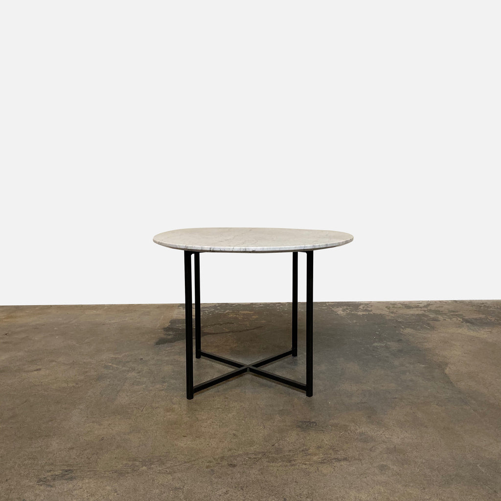This versatile side table with polished marble top and black metal base puts everything within easy reach. It is not too low and the surface is substantial enough for a lamp, books AND the remotes.