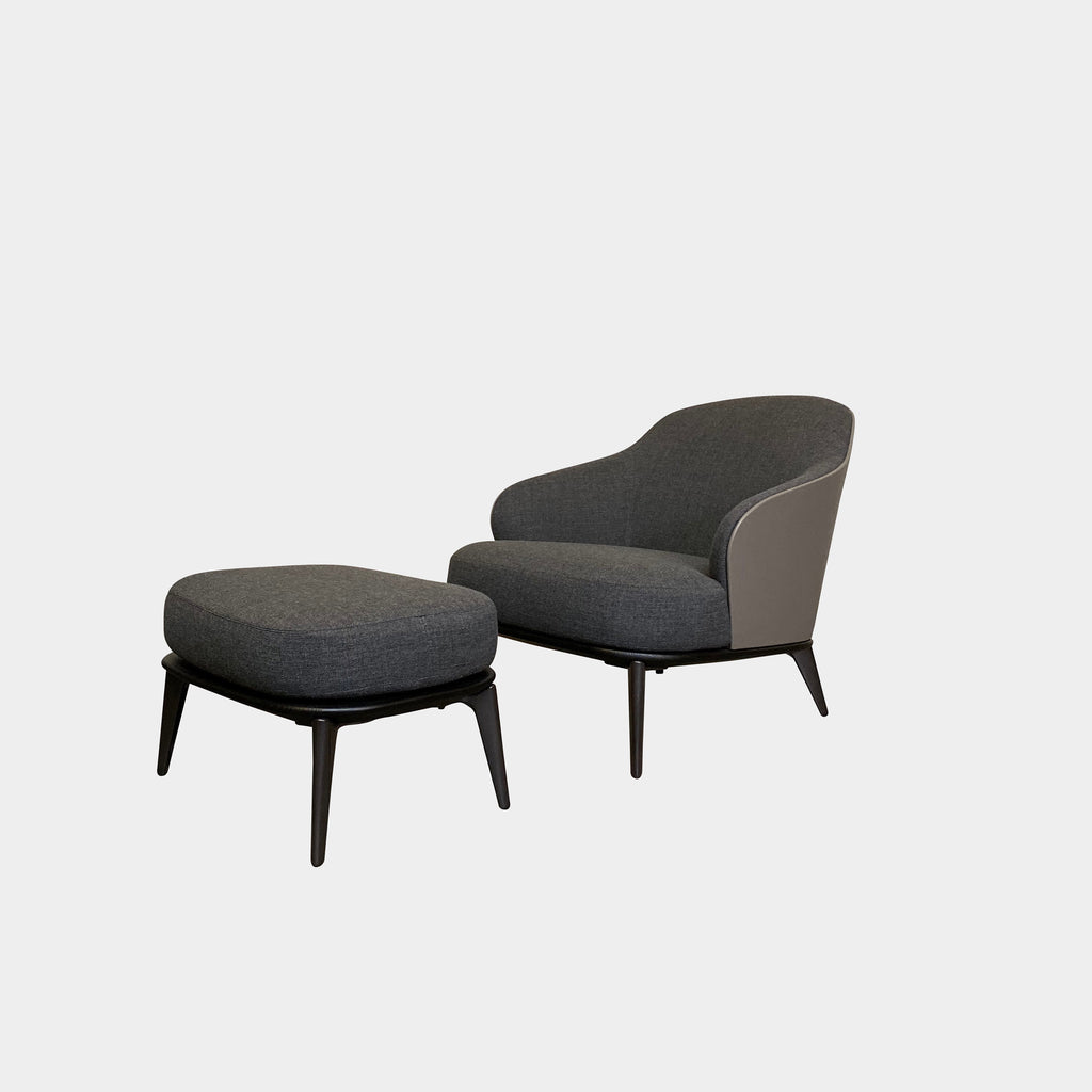 Minotti 'Leslie' Armchair & Ottoman  The Minotti 'Leslie' chair and ottoman is sensuous with soft contours and rich materials. Textured gray fabric is backed by smooth, hard taupe colored leather. An ebony stained wood base defines and compliments.