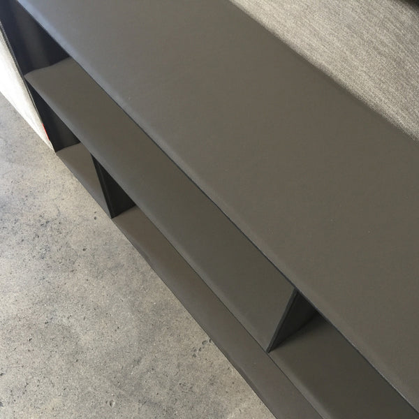 Flexform Gray fabric Groundpiece sectional by Antonio Citterio up close photo of shelf