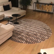 "Kymo ""Extend"" Round Handwoven Area Rug"