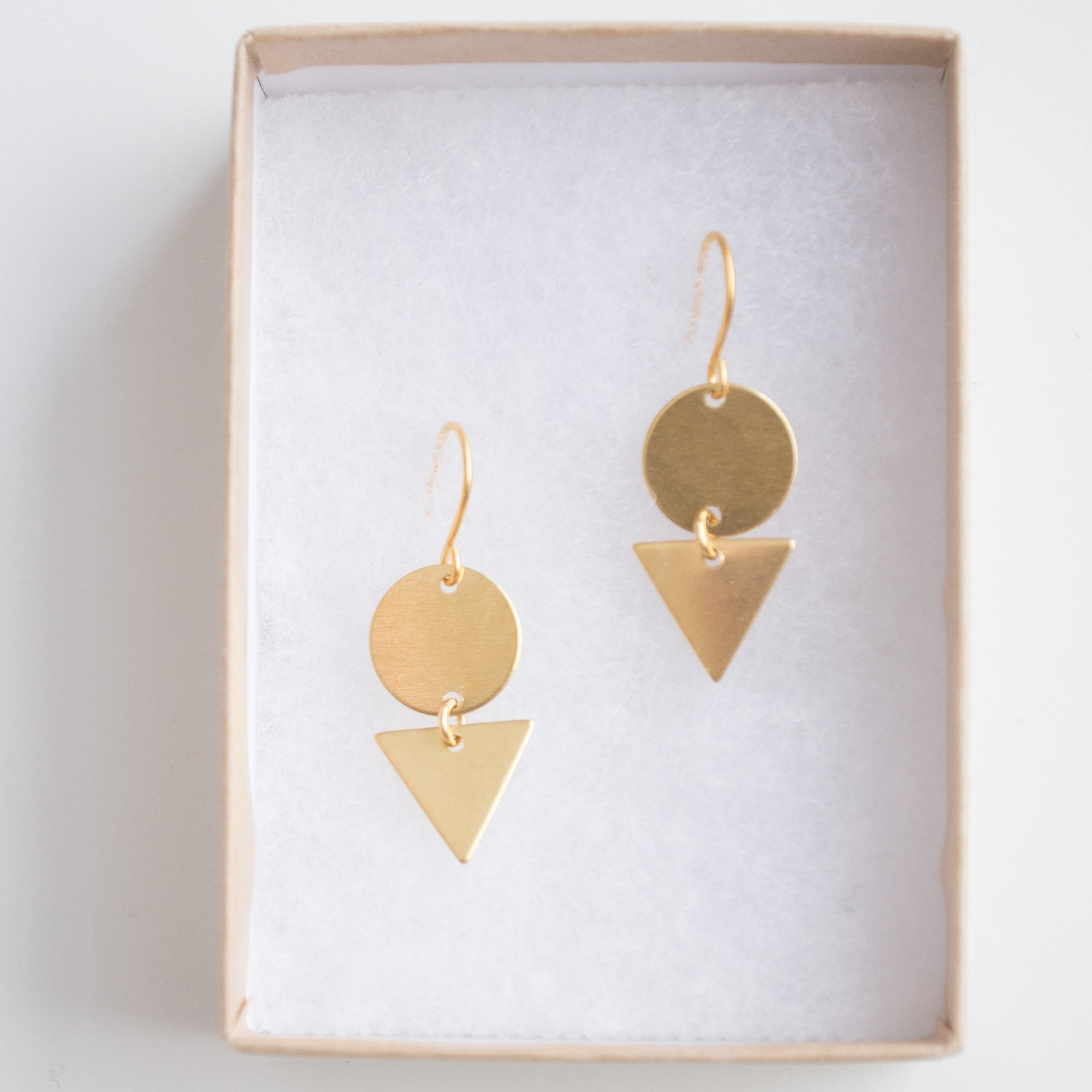 brass and geometric earrings silver index