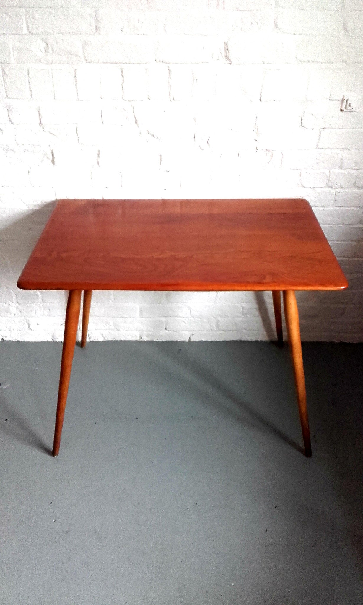 Beautiful pact Ercol Dining Table With Magazine Shelf