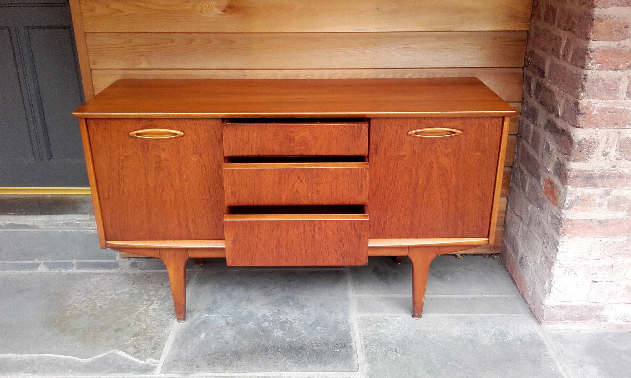 Lovely compact jentique sideboard with sliding doors and unusual lovely compact jentique sideboard with sliding doors and unusual elliptical handles vtopaller Gallery