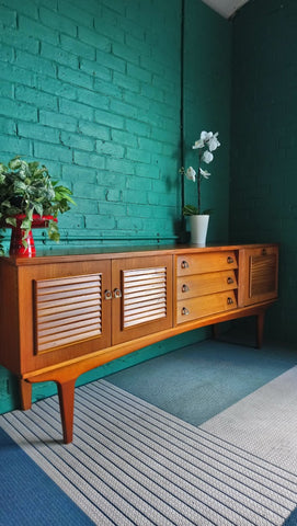 Stylish Sideboard With Louvred Doors And Beehive Drawers