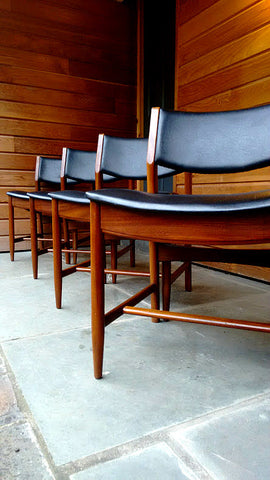 Set Of Four Curvy And Comfortable Dining Chairs In Teak With Black Vinyl Upholstery