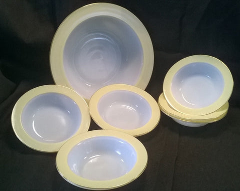 Pyrex white bowls with lemon yellow and gold edging