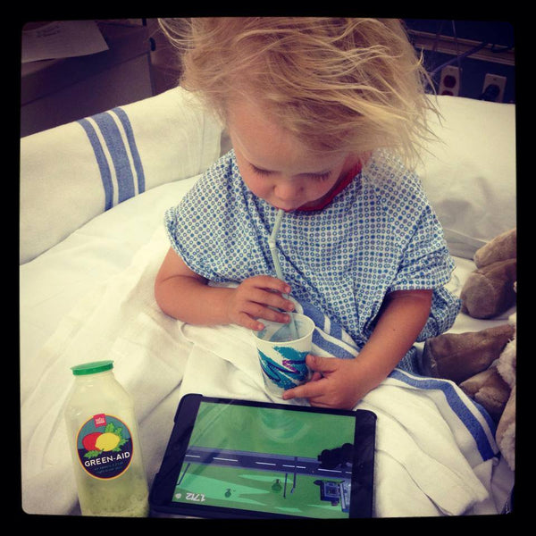 Kicker drinking juice before chemo.