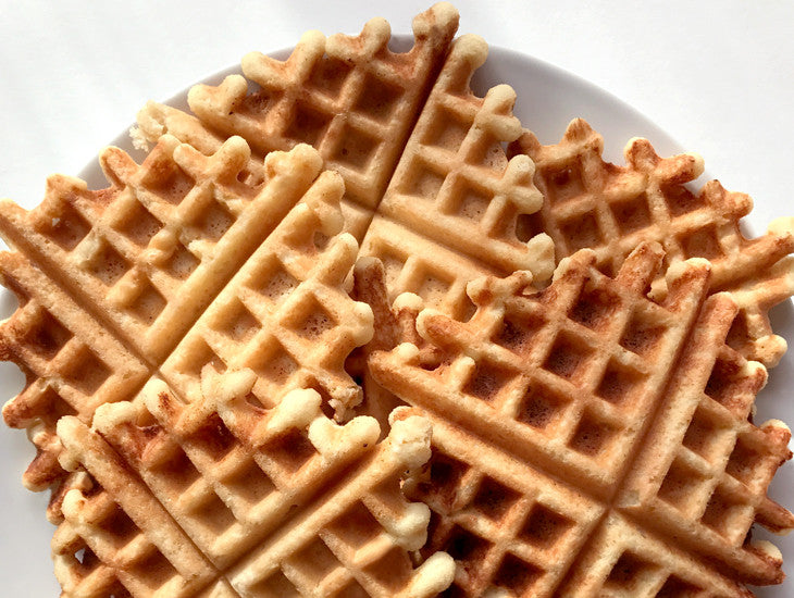 Paleo waffles on a plate, totally gluten free and made with almond flour.  Yum!