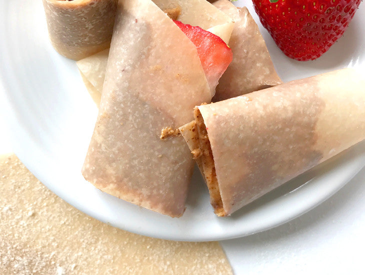 Paleo tortillas on a plate, almond butter & strawberries, yum!
