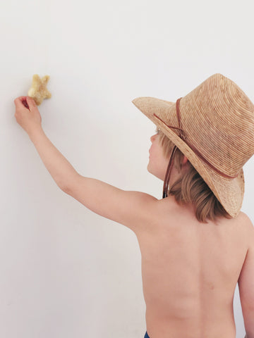boy holding a star with cowboy hat